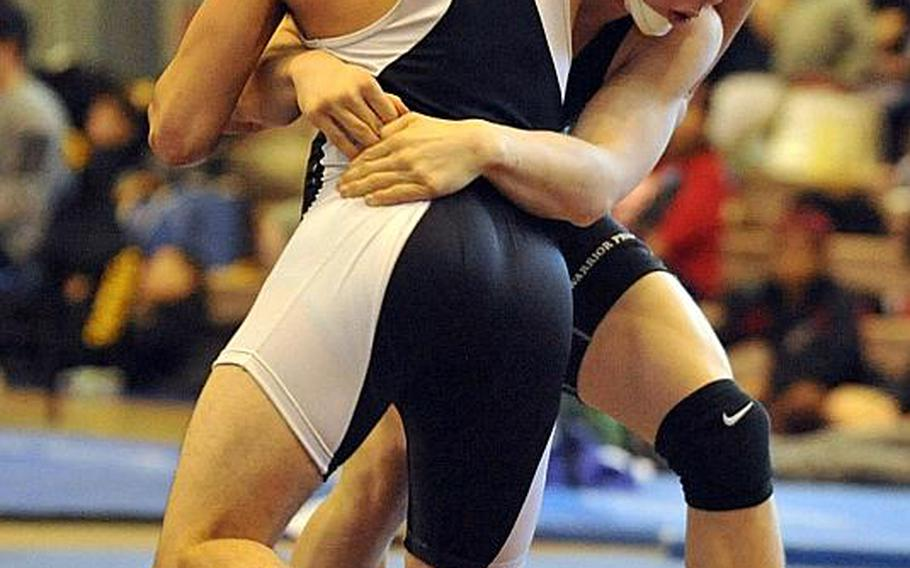 """Hunter Lane, right, a Daegu 148-pounder shown wrestling Zama's Curtis Blunt in the """"Beast of the Far East"""" title bout, said he was grateful for the opportunity to wrestle somebody besides the same ones he sees each week in Korea dual meets. He is one of just four on Daegu's roster."""