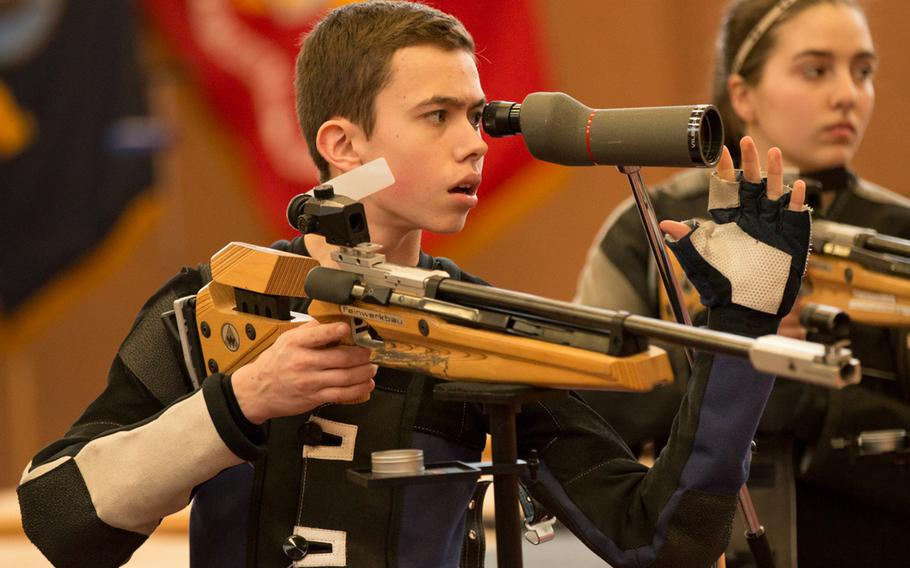 Stuttgart's Callum Funk checks the placement of his shot during the 2016 DODEA-Europe marksmanship finals in Vilseck, Germany, Saturday, Jan. 30, 2016.