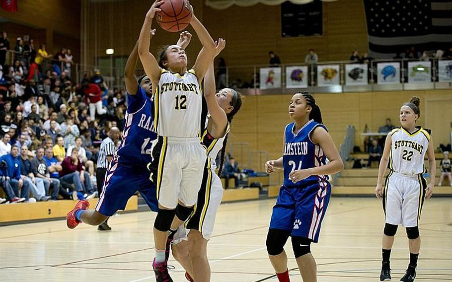 Stuttgart's Marissa Encarnacion goes up for a rebound in front of Ramstein's Essynce Hall during the DODEA-Europe Division I championship in Wiesbaden, Germany, on Saturday, Feb. 25, 2017.