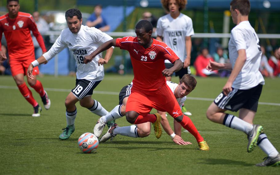 Kaiserslautern's Alexander Dexter gets through the Vicenza defense to score the first of his three goals in the Raiders' 3-2 win over the Cougars in a Division I game at the DODEA-Europe soccer championships in Reichenbach-Steegen, Germany, Thursday, May 19, 2016.