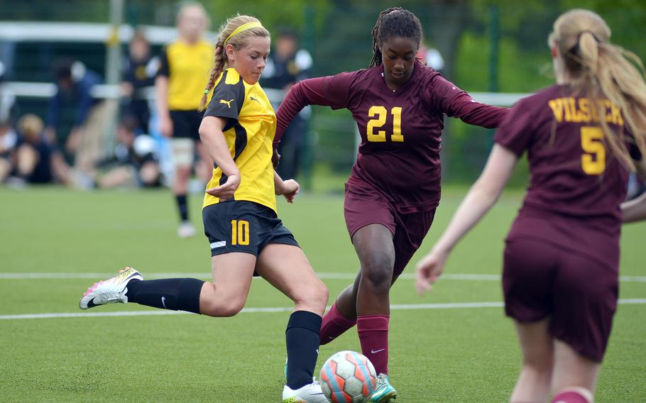 Stuttgart's Lexi McLellan gets off a shot against Vilseck's Marquita Morris, center and Margaret Clearwater in a Division I game on opening day of the DODEA-Europe soccer championships in Reichenbach-Steegen, Germany, Wednesday, May 18, 2016.