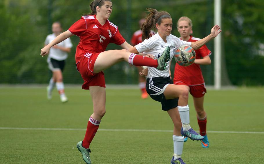 Kaiserslautern's Bethany Salas, left, clears the ball in front of Naples' Micayla Feltner in a Division I game on opening day of the DODEA-Europe soccer championships in Reichenbach-Steegen, Germany, Wednesday, May 18, 2016.