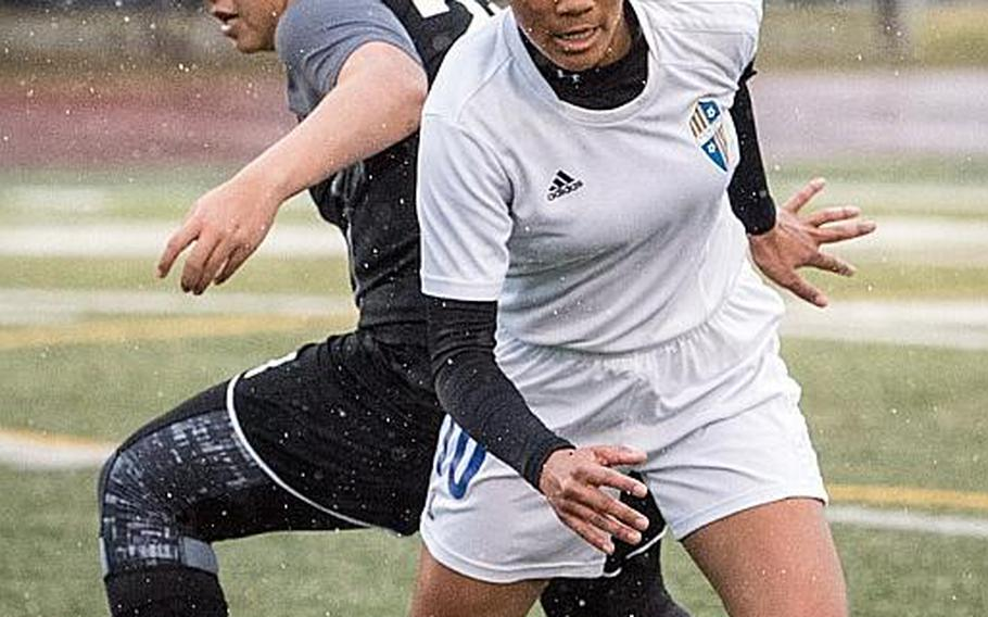 """Yokota's Ai Robbins, battling for the ball with Zama's Reagan Palmer, is one of three juniors whom Panthers coach Matt Whipple calls the """"strike force"""" for the two-time defending Far East Division II tournament champions."""