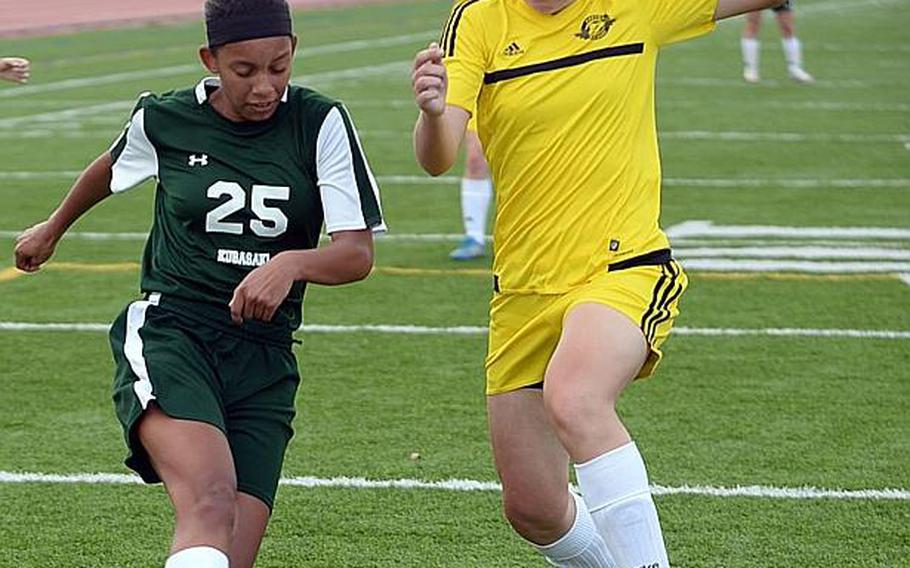 Kubasaki sophomore Myca Ingram, shooting past Kadena sweeper Samantha Murray, scored 34 goals and had five assists last season for the three-time defending Far East Division I Tournament champion Dragons.