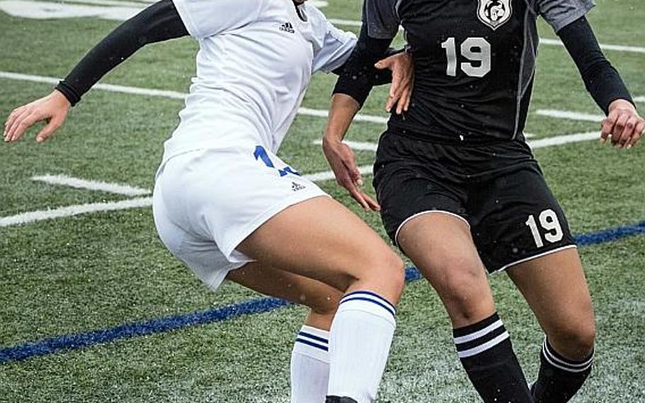 """Yokota's Regina Dukat, battling for the ball with Zama's Armelia Baldwin, is one of three juniors whom Panthers coach Matt Whipple calls the """"strike force"""" for the two-time defending Far East Division II tournament champions."""