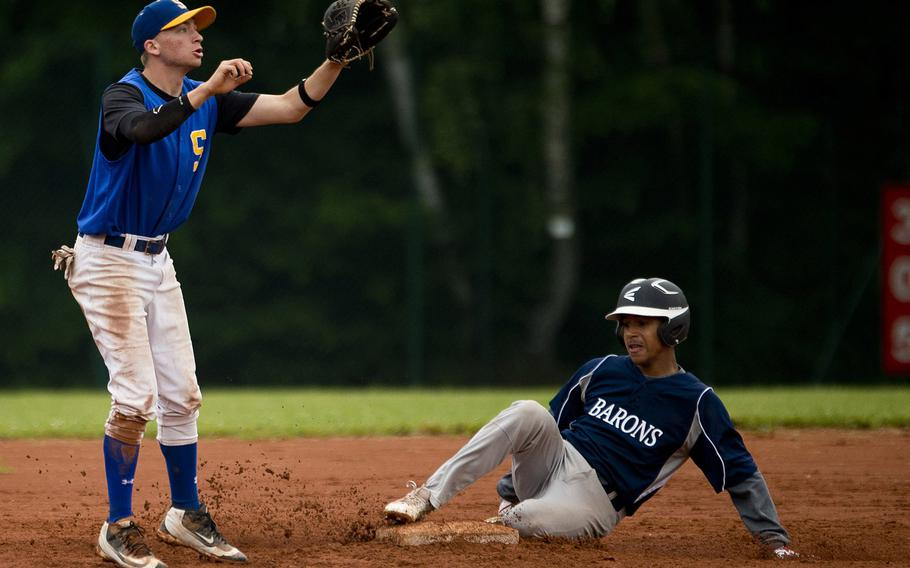 Sigonella's Austin Brehmer, left, jumps for the ball as Bitburg's Tyriq Zvijer slides into second during the DODEA-Europe baseball tournament in Kaiserslautern, Germany, on Friday, May 27, 2016.