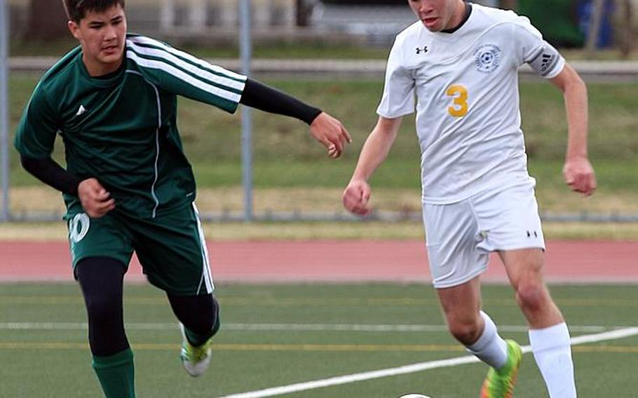 Junior striker Dylan Grimes, right, leads Yokota with 19 goals this season.