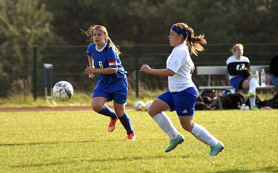 Hohenfels' Nicole Pineiro-Serrano races to the ball against Brussels Juliette Mobley during a game at Hohenfels High School, Friday, April 21.