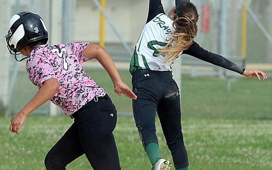 Kubasaki shortstop Leah Bebout snags a line drive in front of Kadena baserunner Alex Dunham during Friday's Game 2 of the Okinawa district softball finals, won by the Dragons 8-4 to complete a two-game sweep.