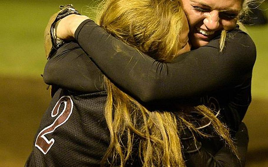 Zama's Krisha Reyes and MVP Ally Chiarenza share a hug after beating Yokota 13-3 in the third of three Far East Division II Softball Tournament final games on Wednesday.  DAVE ORNAUER/STARS AND STRIPES