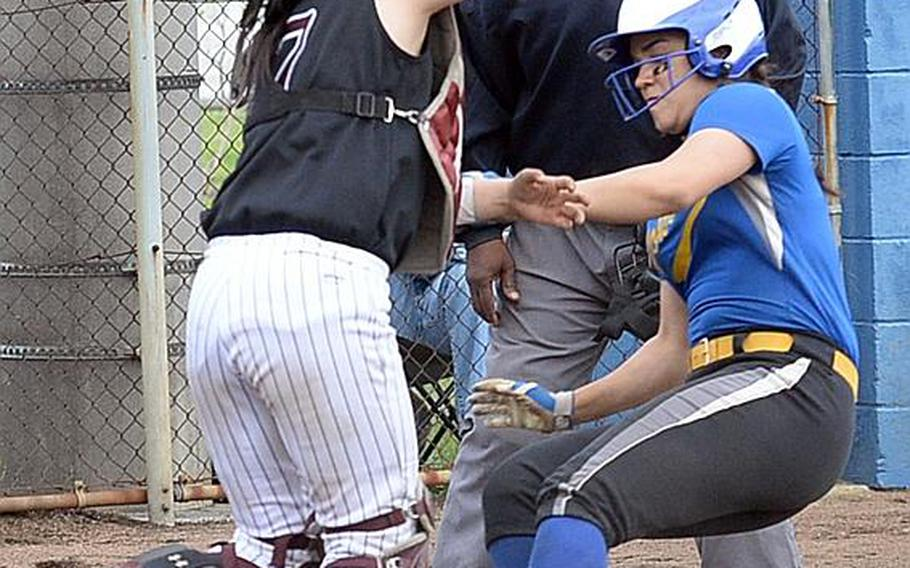 Yokota's Irene Diaz slides into the tag of Zama catcher Ayumi Davis during Wednesday's final games in the Far East Division II Softball Tournament. Yokota won the first two 16-0 and 10-6 before Zama prevailed 13-3 in the third game for the Trojans' first title since 2012.  ANGELA ROOT/SPECIAL TO STRIPES