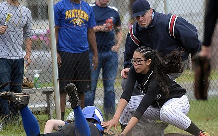 Zama third baseman Litzie Figueroa tags out Yokota's Sally Lambie during Wednesday's final games in the Far East Division II Softball Tournament. Yokota won the first two 16-0 and 10-6 before Zama prevailed 13-3 in the third game for the Trojans' first title since 2012.  ANGELA ROOT/SPECIAL TO STRIPES