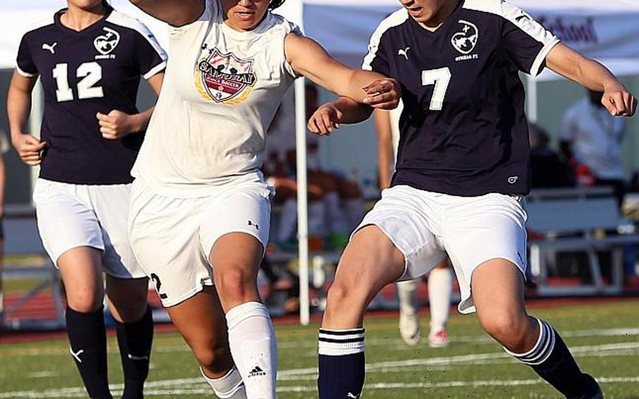 Matthew C. Perry's Hazel Bolduc dribbles between Sacred Heart's Erika Aoki and Karin Kosugi during Thursday's Far East Girls Division II Soccer Tournament final, won by the Samurai 2-0.  AUSTIN LIVENGOOD/SPECIAL TO STRIPES