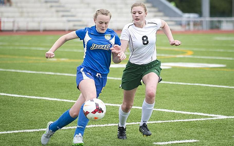 Sigonella's Violender Doke, left, and Alconbury's Haley Starr race for the ball during the DODEA-Europe Division III championship in Kaiserslautern, Germany, on Saturday, May 20, 2017. Sigonella lost the match 1-0 in overtime.  MICHAEL B. KELLER/STARS AND STRIPES