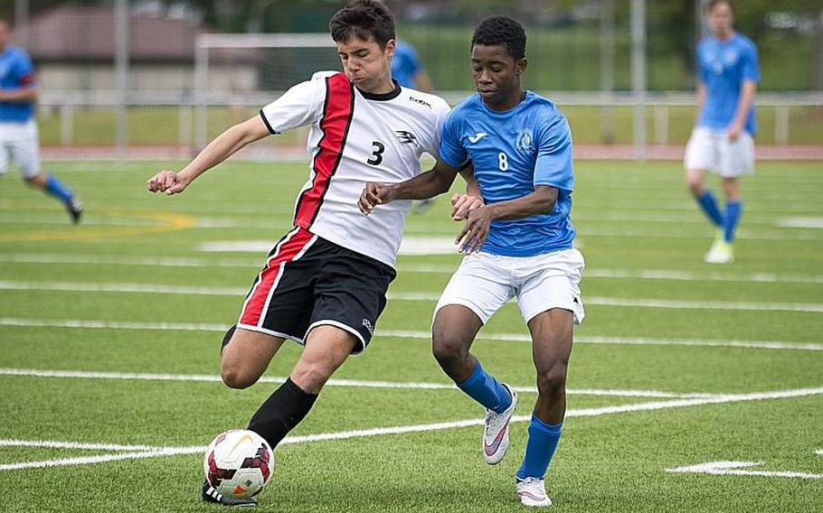 Marymount's Elton Mizine, right, and American Overseas School of Rome's Giuseppe Amara race for the ball during the DODEA-Europe Division II championship in Kaiserslautern, Germany, on Saturday, May 20, 2017. Marymount won the title match 3-2 in overtime.  MICHAEL B. KELLER/STARS AND STRIPES