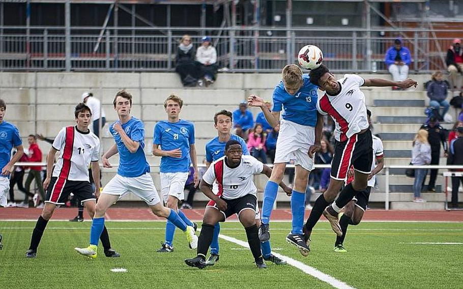 American Overseas School of Rome's Gabriel Smith, right, and Marymount's Asger Lorenzen jump for a header during the DODEA-Europe Division II championship in Kaiserslautern, Germany, on Saturday, May 20, 2017. AOSR lost the match 3-2 in overtime.  MICHAEL B. KELLER/STARS AND STRIPES