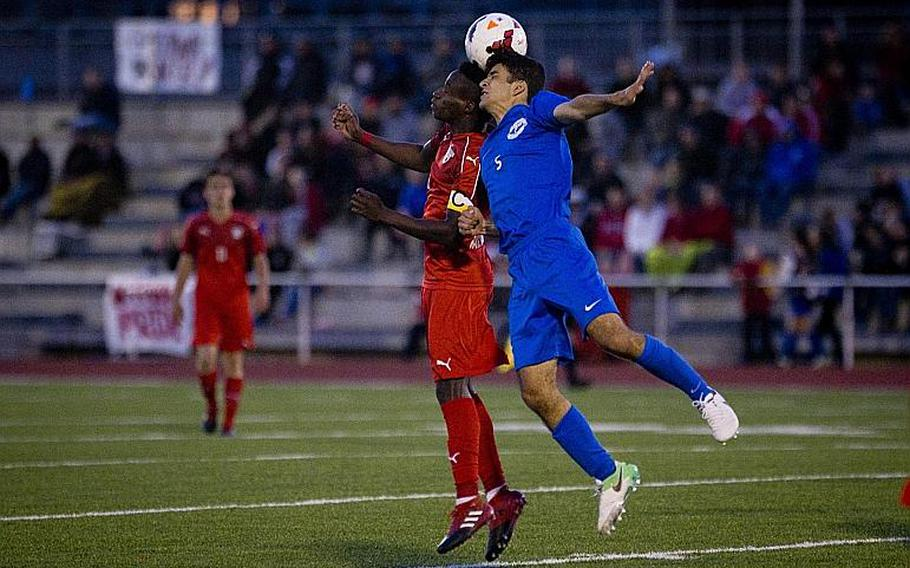 Kaiserslautern's Alexander Dexter, left, and Ramstein's Gerald Donohue jump for a header during the DODEA-Europe Division I championship in Kaiserslautern, Germany, on Saturday, May 20, 2017. Kaiserslautern won the title match 3-1.