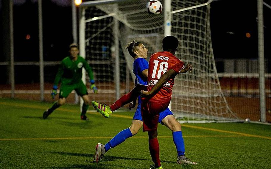 Kaiserslautern's Daniel Hilton, right, takes a shot over Ramstein's Cole Khosrovani during the DODEA-Europe Division I championship in Kaiserslautern, Germany, on Saturday, May 20, 2017. Kaiserslautern won the title match 3-1.
