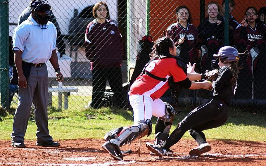 Kaiserslautern's Christine Capalar tags out Vilseck's Natasha Murray before she can score Saturday, but plenty of Falcons did score in a 12-3, 12-1 doubleheader sweep.  MARTIN EGNASH/STARS AND STRIPES
