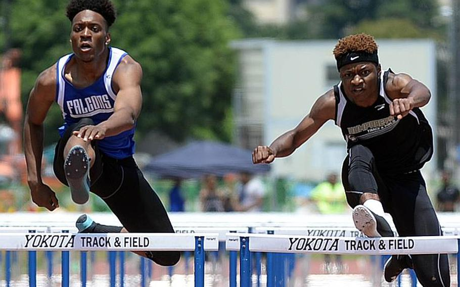 Seoul American's Christian Williams and Humphreys' Tim Ward negotiate the 110 hurdles, side-by-side, in the Far East track and field meet. The two hit the finish .01 seconds apart. Williams won the Division I title in 16.37 seconds and Ward the Division II in 16.38.  DAVE ORNAUER/STARS AND STRIPES