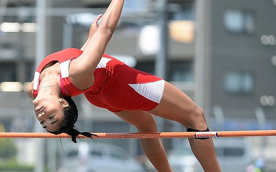 Nile C. Kinnick junior Exotica Hall clears the high jump bar in the Far East track and field meet. Hall won in a meet-record 1.60 meters, topping the previous mark of 1.56 which stood for five years.  DAVE ORNAUER/STARS AND STRIPES