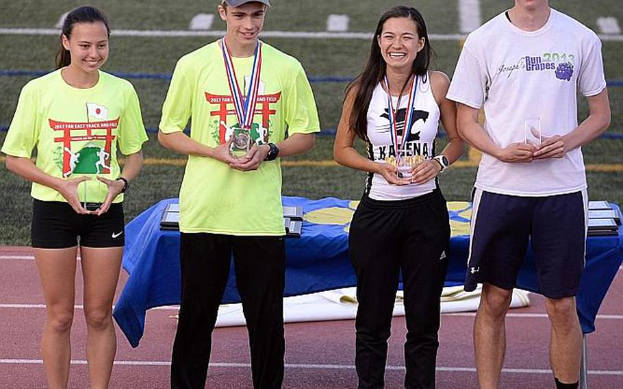 The Athletes of the Meet. From left, Zama's Jessica Hibler and Hunter Lund in Division II, and Kadena's Wren Renquist and American School In Japan's Britt Sease in Division I.  DAVE ORNAUER/STARS AND STRIPES