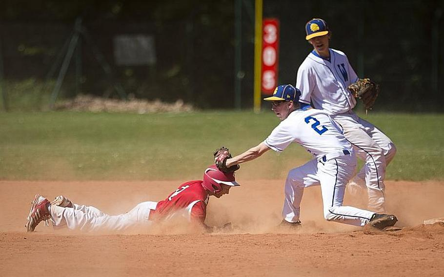 Wiesbaden's Parker Crumbly, right, tags out Kaiserslautern's Caleb Moffat at second during the DODEA-Europe baseball tournament in Kaiserslautern, Germany, on Friday, May 26, 2017. Wiesbaden won the Division I game 11-7 and advances to the semifinals.  MICHAEL B. KELLER/STARS AND STRIPES