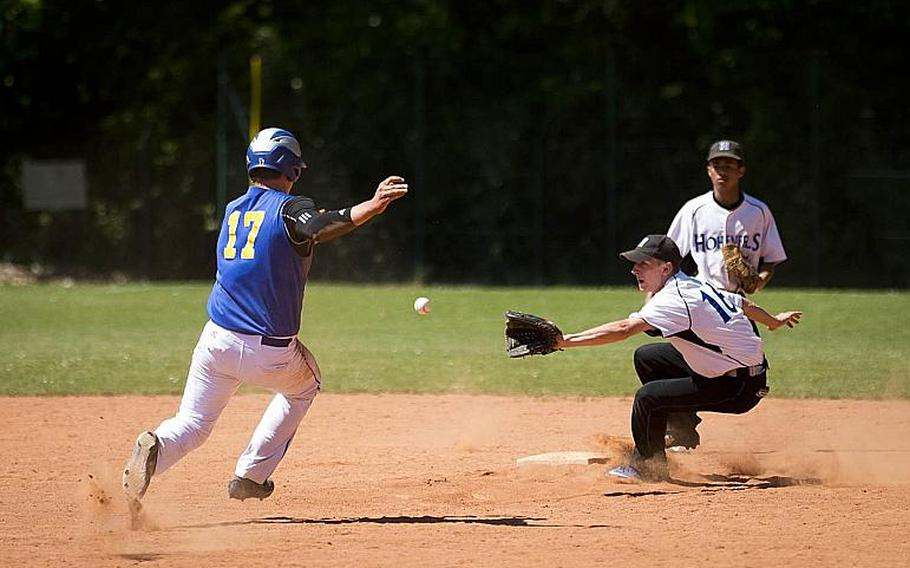Sigonella's Alex Ogletree, left, tries to slide into second before a throw to Hohenfels' Gabe D'Amato during the DODEA-Europe baseball tournament in Kaiserslautern, Germany, on Friday, May 26, 2017. Sigonella won the game 14-3 and advances to the semifinals.  MICHAEL B. KELLER/STARS AND STRIPES