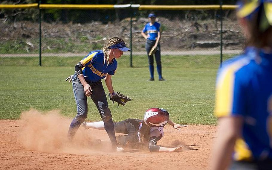Wiesbaden's Grace Turner, left, tags Kaiserslautern's Phoenix Whisennand out at second during the DODEA-Europe softball tournament at Ramstein Air Base, Germany, on Friday, May 26, 2017. Wiesbaden lost the game 10-5.  MICHAEL B. KELLER/STARS AND STRIPES