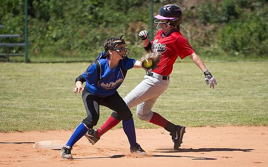 Bitburg's Alicia Paul, right, runs to third ahead of a throw to Hohenfels' Aliyah Jordan during the DODEA-Europe softball tournament at Ramstein Air Base, Germany, on Friday, May 26, 2017. Bitburg won the Division II/III game 10-4.  MICHAEL B. KELLER/STARS AND STRIPES