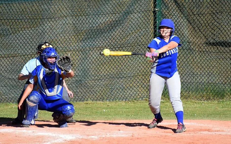 Rota's Grace Lagger hits the ball during a game against Sigonella during the second day of the softball championships at Kaiserslautern, Friday, May 26.