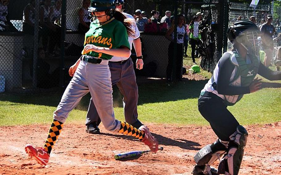 SHAPE's Josie Whitaker runs across home plate during a game against Naples during the second day of the softball championships at Kaiserslautern, Friday, May 26.