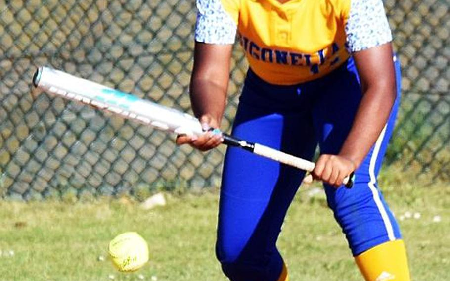 Sigonella's Latatayana Jefferson bunts the ball during a game against Rota during the second day of the softball championships at Kaiserslautern, Friday, May 26.