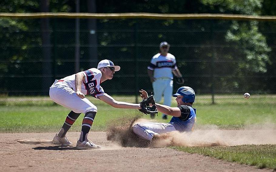 Sigonella's Alex Ogletree, right, slides to second ahead of a throw to Bitburg's Max Little during the DODEA-Europe Division II/III baseball championship at Ramstein Air Base, Germany, on Saturday, May 27, 2017. Sigonella won the game 10-1.  MICHAEL B. KELLER/STARS AND STRIPES