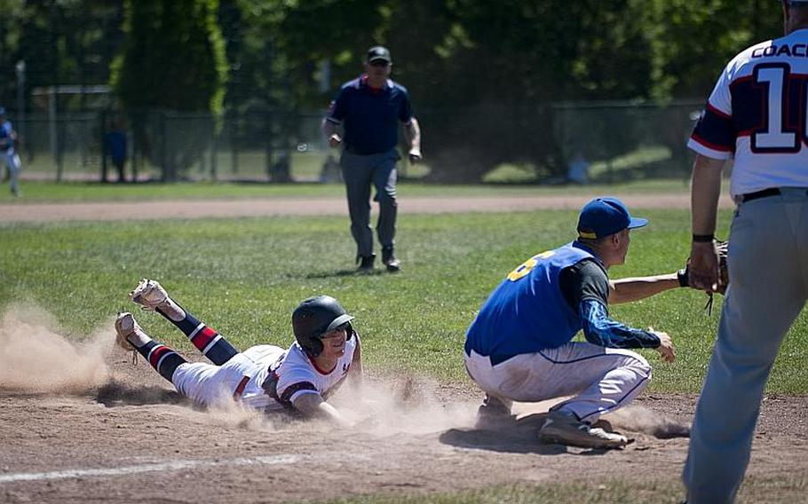 Bitburg's Max Little, left, slides to third before a tag by Sigonella's Ethan Lopez during the DODEA-Europe Division II/III baseball championship at Ramstein Air Base, Germany, on Saturday, May 27, 2017. Bitburg lost the game 10-1.  MICHAEL B. KELLER/STARS AND STRIPES