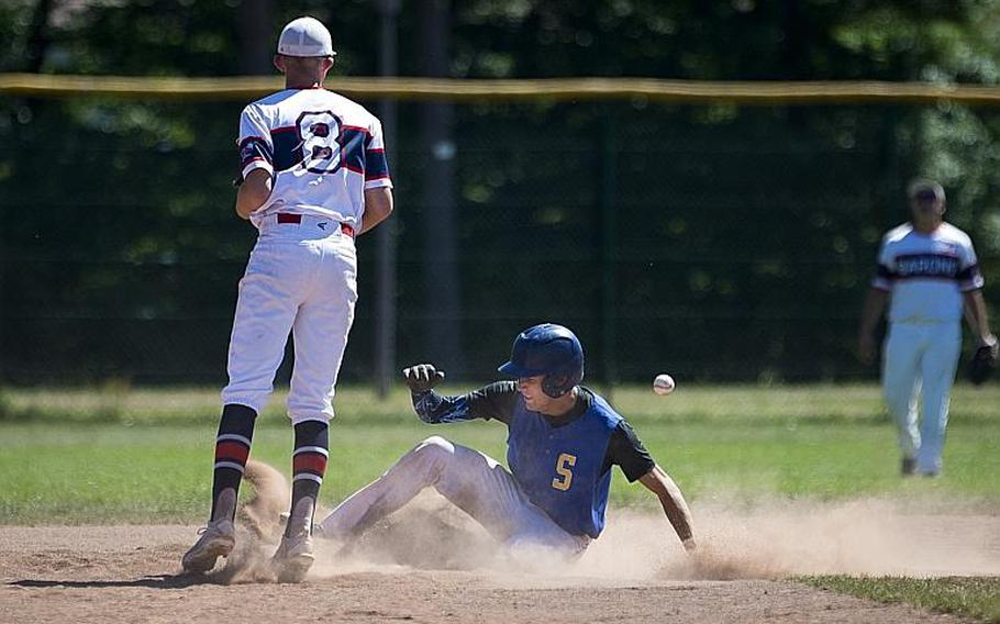 Sigonella's Ethan Lopez, right, slides to second in front of Bitburg's Max Little during the DODEA-Europe Division II/III baseball championship at Ramstein Air Base, Germany, on Saturday, May 27, 2017. Sigonella won the title game 10-1.  MICHAEL B. KELLER/STARS AND STRIPES