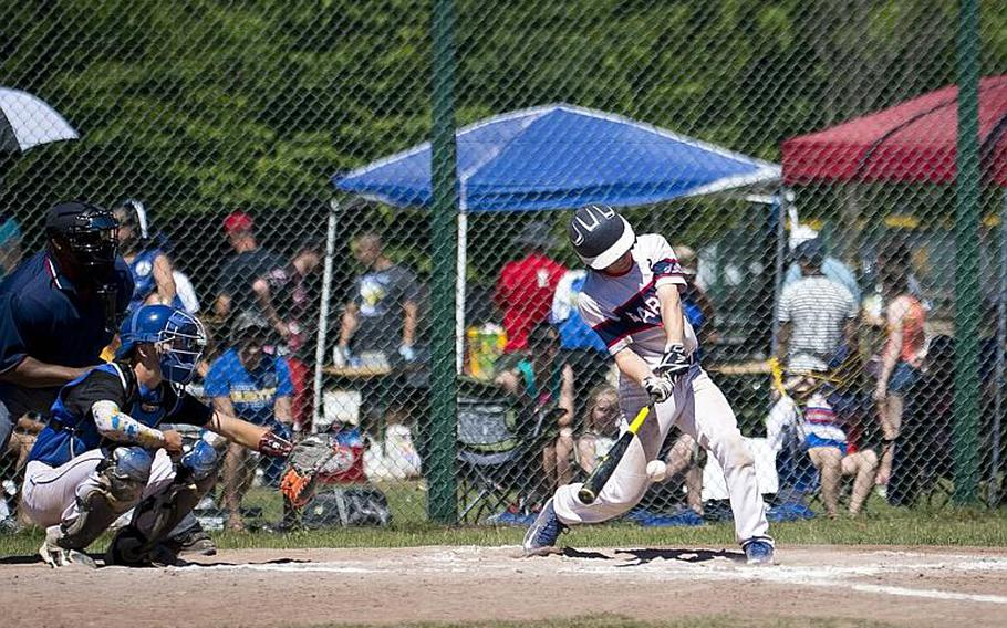 Bitburg's Wesley Wade hits the ball during the DODEA-Europe Division II/III baseball championship at Ramstein Air Base, Germany, on Saturday, May 27, 2017. Bitburg lost the game against Sigonella 10-1.  MICHAEL B. KELLER/STARS AND STRIPES