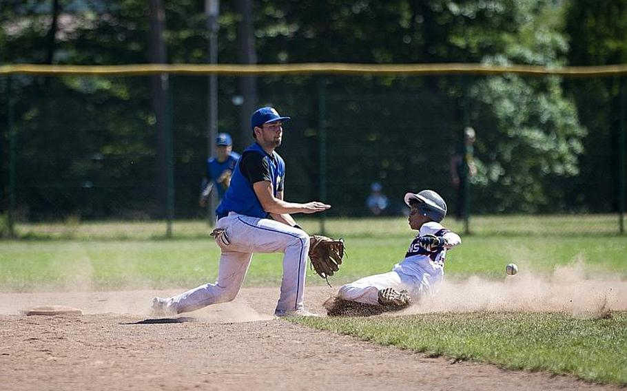 Bitburg's Deon Montgomery, right, slides to second ahead of a throw to Sigonella's Keith Guy during the DODEA-Europe Division II/III baseball championship at Ramstein Air Base, Germany, on Saturday, May 27, 2017. Bitburg lost the game 10-1.  MICHAEL B. KELLER/STARS AND STRIPES