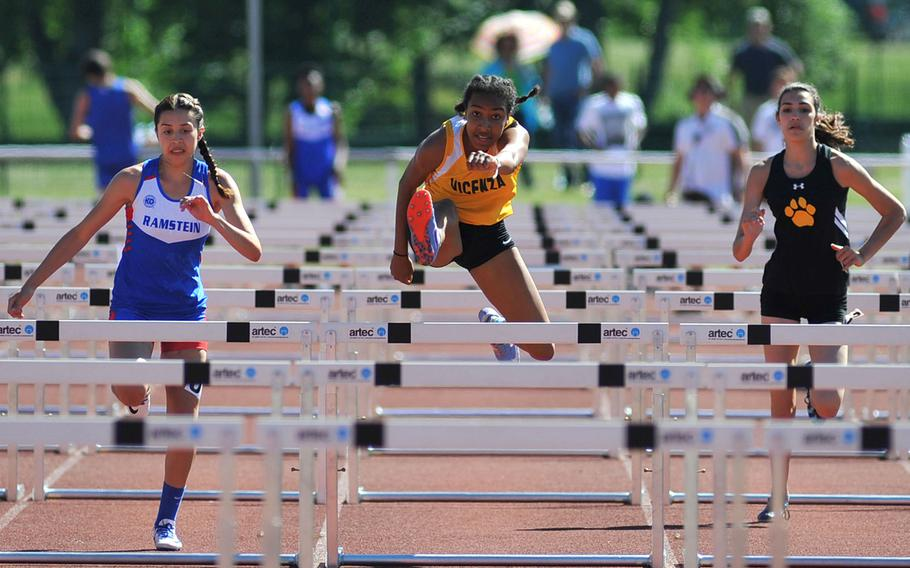Vicenza's Brandy James, center, on her way to winning the 100-meter hurdles race at the DODEA-Europe track and field finals in Kaiserslautern, Germany, Saturday, May 27, 2017. She won in 15.74 seconds. At left is Ramstein's Sybella Crespo, who was second and Stuttgart's Annika Rivera, who was fifth.