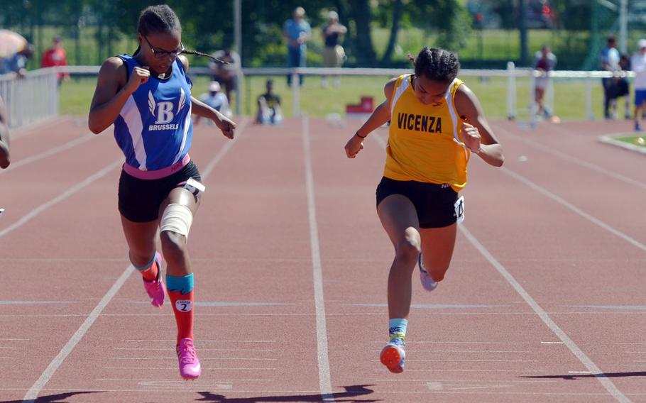 Brussels' Tariziana Thompson, left, beats Vicenza's Brandy James to the finish line in the 100-meter dash at the DODEA-Europe track and field finals in Kaiserslautern, Germany, Saturday, May 27, 2017. Thompson won in 12.75 seconds ahead of 12.83 for James.