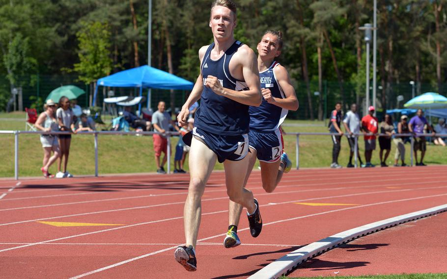 Ramstein's Colin McLaren leads Lakenheath's Austin Burt onto the back stretch in the 1600-meter race at the DODEA-Europe track and field finals in Kaiserslautern, Germany, Saturday, May 27, 2017. Burt passed McLaren on the home stretch to win the race in a new DODEA-Europe record of 4 minutes, 24.18 seconds. McLaren's 4:24.86 also would have beat the old record.