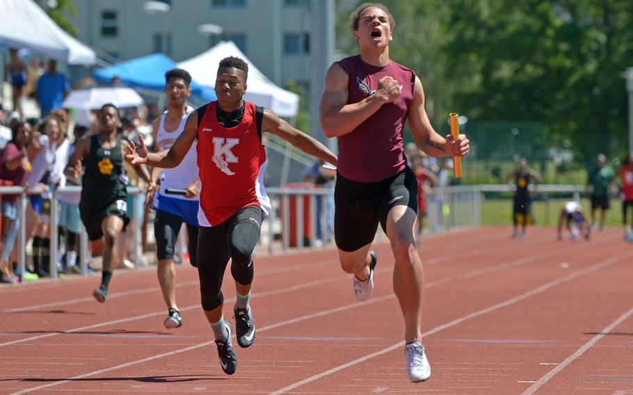 Vilseck's Zavier Scott celebrates after anchoring the 4x100-meter relay team at the DODEA-Europe track and field finals in Kaiserslautern, Germany, Saturday, May 27, 2017. Scott and teammates Corey Coombs, Hayden Swan and Devin Gamble won the race in 43.95 seconds.