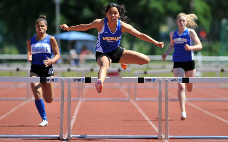 Wiesbaden's Clarissa Paniagua takes the last hurdle, on her way to winning the 300-meter hurdles race at the DODEA-Europe track and field finals in Kaiserslautern, Germany, Saturday, May 27, 2017. Her winning time was 46.67 seconds. At left is Evin Harper of Brussels, at right Wiesbaden's Brigantia O'Sadnick, who finished second and third.