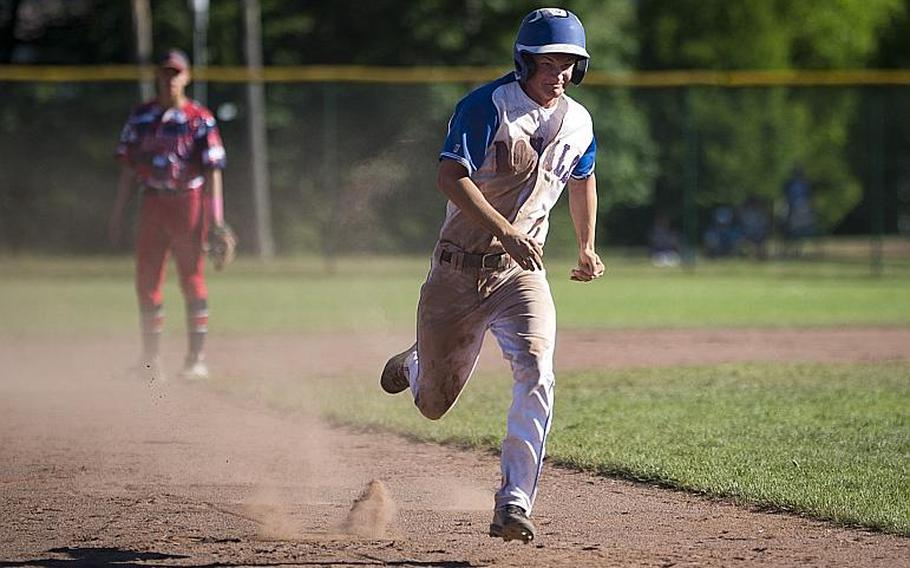 Ramstein's Reed Marshall runs to third during the DODEA-Europe Division I baseball championship at Ramstein Air Base, Germany, on Saturday, May 27, 2017. Ramstein won the title game against Lakenheath 8-6.  MICHAEL B. KELLER/STARS AND STRIPES