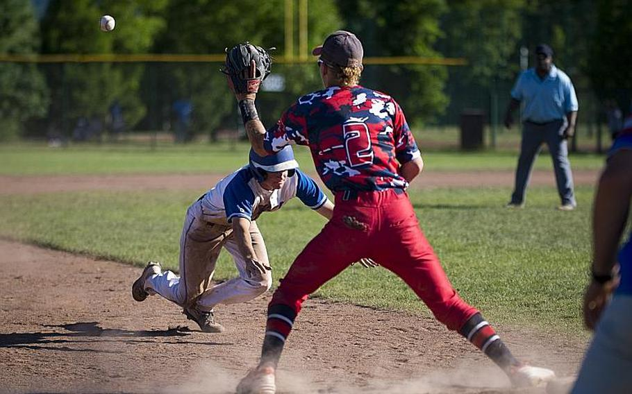Ramstein's Reed Marshall dives to third under a throw to Lakenheath's Kaiden Morales during the DODEA-Europe Division I baseball championship at Ramstein Air Base, Germany, on Saturday, May 27, 2017. Ramstein won the game 8-6.  MICHAEL B. KELLER/STARS AND STRIPES
