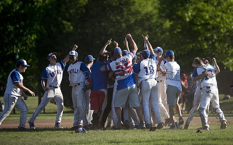 Ramstein celebrates winning the DODEA-Europe Division I baseball championship at Ramstein Air Base, Germany, on Saturday, May 27, 2017. Ramstein defeated Lakenheath 8-6 to win the title.  MICHAEL B. KELLER/STARS AND STRIPES