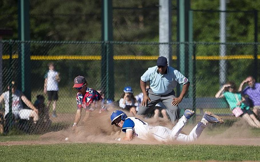 Ramstein's Tieran Shoffner, right, slides to third ahead of a tag by Lakenheath's Kaiden Morales during the DODEA-Europe Division I baseball championship at Ramstein Air Base, Germany, on Saturday, May 27, 2017. Ramstein won the game 8-6.  MICHAEL B. KELLER/STARS AND STRIPES