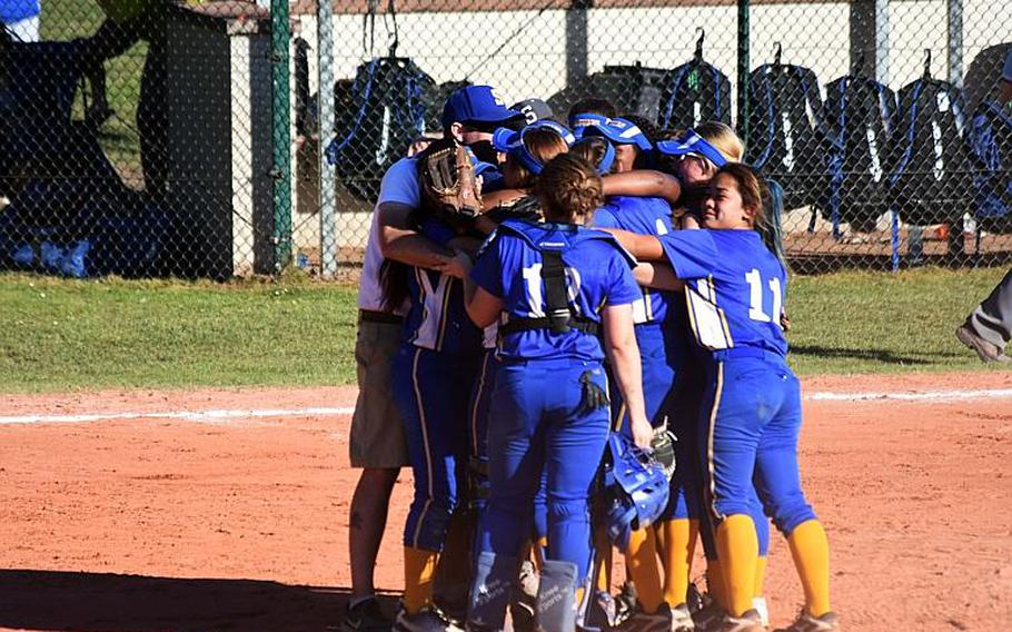 The Sigonella softball team gathers on field after a championship game win against Bitburg at Ramstein Air Base,  Germany on Saturday, May 27.