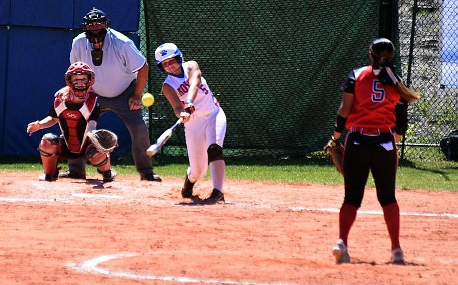 Ramstein's Brea Mangham hits a ball pitched by Kaiserslautern's Ally Alamos during the semifinal game at Ramstein Air Base, Germany on Saturday, May 27.