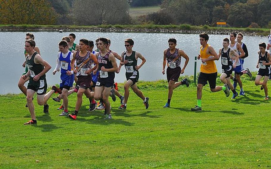 A pack of runners race past a small pond on the Baumholder Army Golf Course on Saturday. The runners were competing in the 2016 DODEA European cross country championships in Baumholder, Germany.